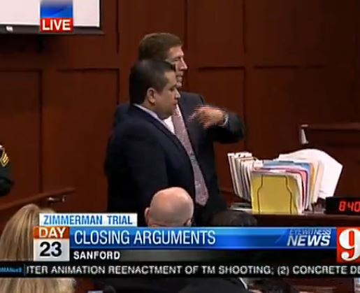 Zimmerman stands during closing