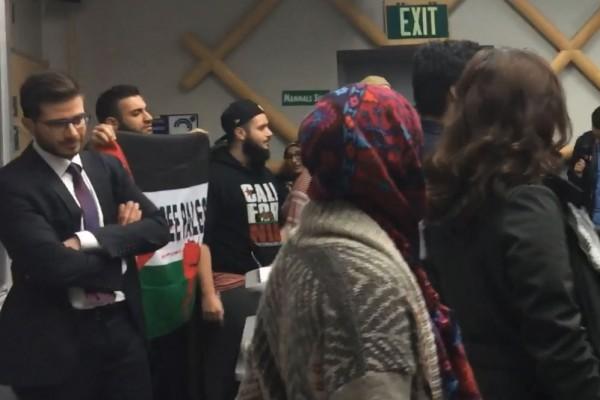 UC Davis SJP Shout Down Israeli Arab Diplomat George Deek behind protesters