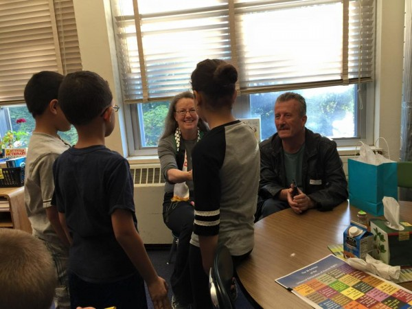 [Bassem Tamimi and Mary Anne Grady Flores with students at Beverly J. Martin Elementary School]