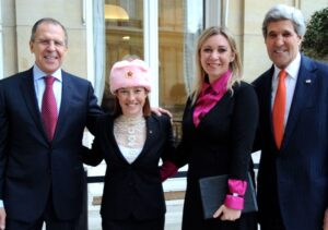 https://en.wikipedia.org/wiki/Jen_Psaki#/media/File:Spokesperson_Psaki_Poses_in_a_New_Hat_With_Russian_Counterpart_and_Their_Respective_Bosses_(11930586556).jpg